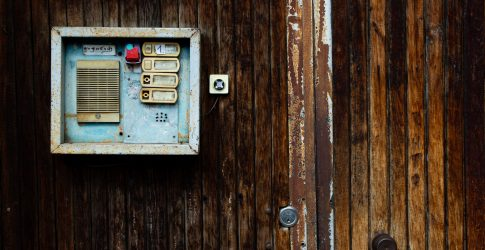 old intercom on wooden wall acrobits